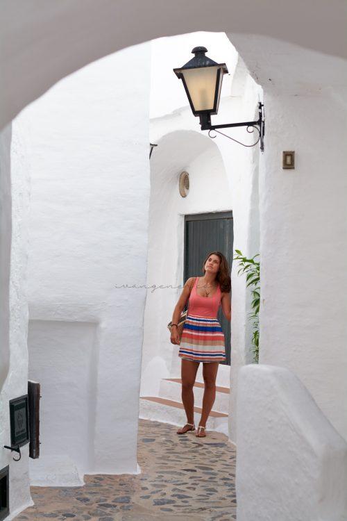 Young millennial traveler exploring a small mediterranean village in Menorca